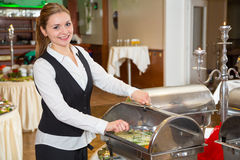 Catering service employee preparing buffet Royalty Free Stock Photo