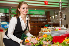 Catering service employee preparing a buffet Royalty Free Stock Image
