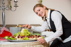 Catering service employee or waitress preparing a buffet Stock Photos