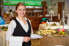 Catering service employee or waitress with a tray of appetizers Stock Photo