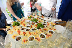 Catering service plate .appetizing sandwiches on plastic sticks rangeSandwiches on a table the buffet Stock Photos