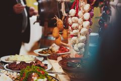 Catering service. Restaurant table with food. Huge amount of food on the table. Plates of food. Dinner time, lunch.  Stock Image