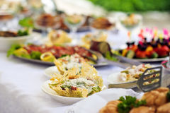 Catering service. Restaurant table with food. Huge amount of  on the . Plates  . Dinner time. Catering service. Restaurant table with food. Huge amount of food Royalty Free Stock Photos
