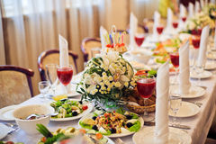 Catering service. Restaurant table with food. Huge amount of  on the . Plates  . Dinner time. Royalty Free Stock Photo