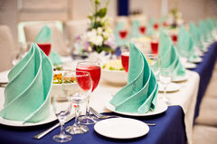Catering service. Restaurant table with food. Huge amount of  on the . Plates  . Dinner time. Stock Photo