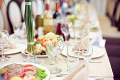 Catering service. Restaurant table with food. Huge amount of on the . Plates . Dinner time. Catering service. Restaurant table with food. Huge amount of food on Stock Image