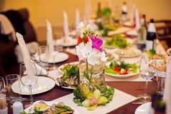 Catering service. Restaurant table with food. Huge amount of on the . Plates . Dinner time. Catering service. Restaurant table with food. Huge amount of food on Stock Images