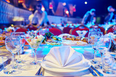 Catering service. set table. Catering service. Restaurant set table with food at event. Natural authentic shot in challenging light condition Royalty Free Stock Photos