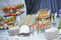Catering service table with food set. Catering services background with snacks on guests table in restaurant at event party Stock Photography