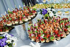 Catering service table with food set Stock Photos