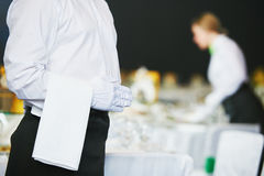 Catering service. waiter on duty in restaurant. Catering waiter occupation. Young man servicing in restaurant during the event Stock Image