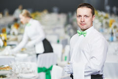 Catering service. waiter on duty in restaurant. Catering waiter occupation. Young men servicing in restaurant during the event Stock Image