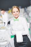 Catering service. waitress on duty. Catering waitress occupation. Young woman servicing in restaurant during the party event Stock Image
