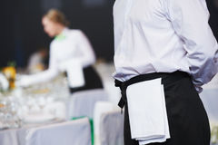 Catering service. waitress on duty in restaurant. Catering waiter occupation. Young woman waitress servicing in restaurant during the event Royalty Free Stock Image