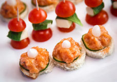 Catering services. Background with snacks and cherry tomatoes Royalty Free Stock Photos