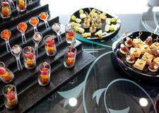 Catering services background with snacks on guests table Stock Photos