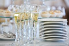 Catering services. Glasses with wine in row background at restaurant party. royalty free stock image