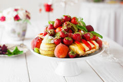 Catering serving of fresh fruits on white table Stock Photo