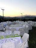 Catering setup at dusk. Overview of catering setup, wedding reception Stock Photos