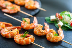 Catering shrimp brochettes. Stock Photos