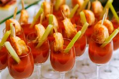 Catering - snack coctails with tomato juice and shrimps Royalty Free Stock Photos