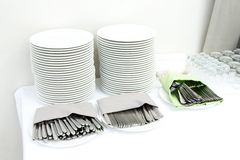 Catering - stacks of plates and cutlery Royalty Free Stock Photography