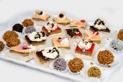 Catering sweets, closeup of various kinds of cakes on event or wedding reception. Selective focus stock photography
