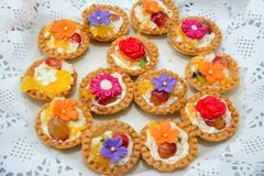 Catering sweets, closeup of various kinds of cakes on event or wedding reception. Selective focus royalty free stock image