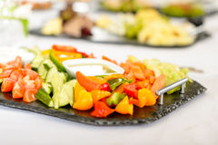 Catering table buffet vegetable salad plate Stock Photos