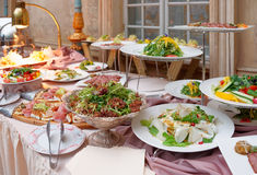 Catering table full of food Stock Photos