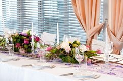 Catering table set with flowers Stock Photography