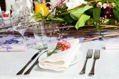 Catering table set with flowers Stock Photo