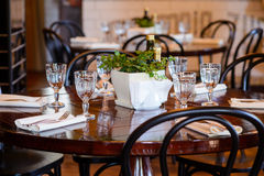 Catering table set. Service with empty glasses , napkin and table stock image