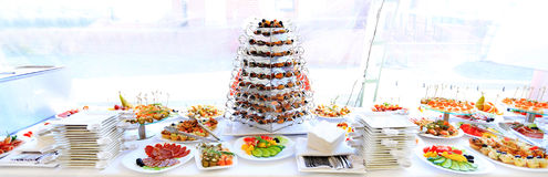 Catering table set service with silverware. And glass stemware at restaurant before party Stock Photo