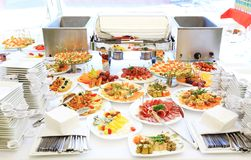 Catering table set service with silverware Stock Images