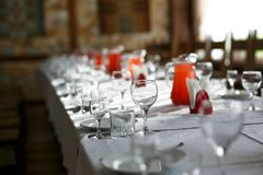 Catering table set service with silverware, napkin and glass at restaurant before party Royalty Free Stock Photos