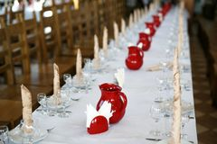 Catering table set service with silverware, napkin and glass at restaurant before party Stock Photos