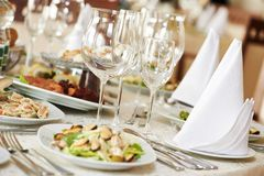 Catering table set. Catering services background with snacks and glasses of wine on bartender counter in restaurant Stock Photography