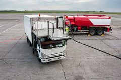 Catering truck and refueling truck on airport apron Royalty Free Stock Images