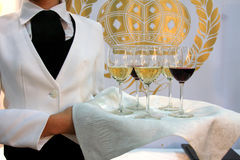 Catering waiter with wine Royalty Free Stock Photography