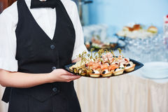Catering waitress service. woman at restaurant event Stock Photos