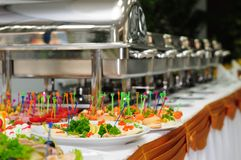 Catering wedding. Chafing dishes at table ready for wedding catering Royalty Free Stock Image