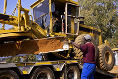 Caterpillar 140H Transport Stock Photo