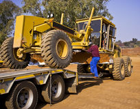Caterpillar 140H Transporter Royalty Free Stock Photo
