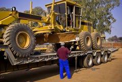 Free Caterpillar 140H Transporter - On Flatbed Trailer Stock Image - 6170511