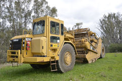 Caterpillar Cat. This heavy-duty 623G Caterpillar Cat Scraper, it is been used to put in a new road on a Vineyard property in New South Wales in Australia Royalty Free Stock Photography