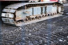 Caterpillar continuous tracks close up of digger on construction site royalty free stock images