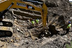 Caterpillar excavating machine digging a deep hole Stock Photography
