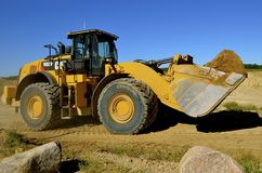 Caterpillar front end loader carrying sand Stock Image