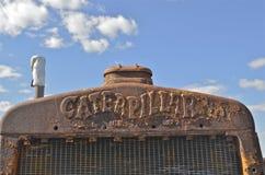 Caterpillar galler av en gammal bulldozer Arkivfoto